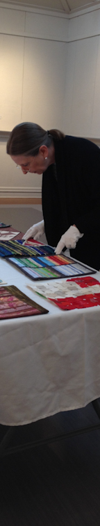 Tracey Lawko judging miniature quilts